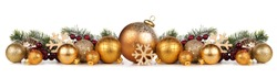 Christmas border of gold ornaments with branches. Side view isolated on a white background.