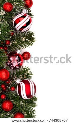 Christmas border of red and white baubles with branches isolated on a white background #744308707