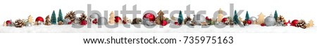 Christmas border or banner with ornaments arranged in a row on snow, extra wide and isolated on white background #735975163