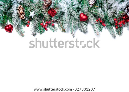 Christmas Border. Tree branches with baubles, stars, snowflakes isolated on white #327381287
