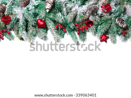 Christmas Border. Tree branches with baubles, stars, snowflakes isolated on white #339063401