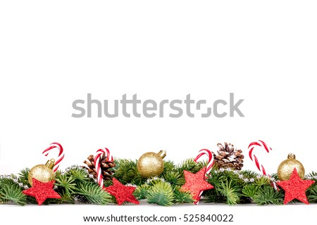 Christmas Border - tree branches with golden balls, candy and big star isolated on white #525840022
