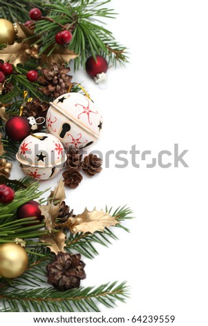 Christmas border with jingle bells and other Christmas ornaments and decorations isolated on white. Shallow dof