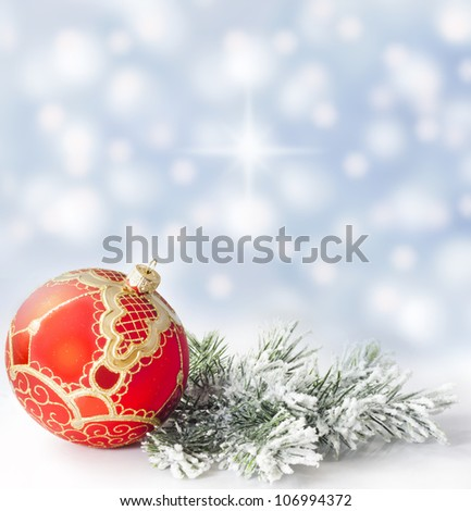 Christmas branch of tree red bauble against snow background