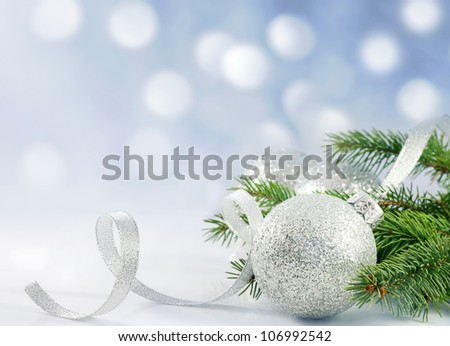 Christmas branch of tree ribbon and bauble against snow background creative concept #106992542