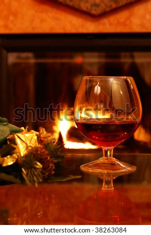 Christmas brandy by fireplace