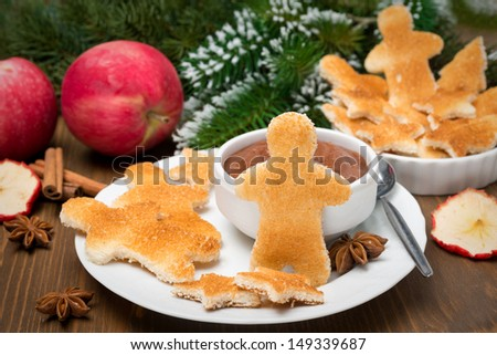 Christmas breakfast - toast in the shape of little men with chocolate and apple butter, horizontal
