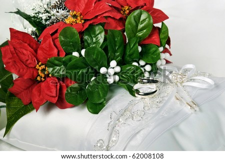stock photo christmas bridal bouquet on satin pillow with rings