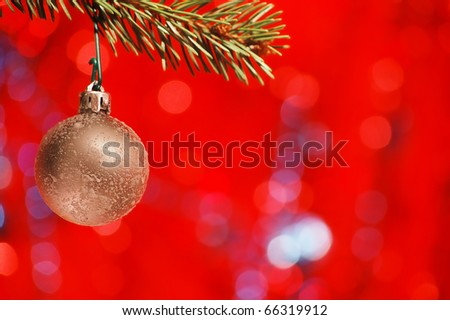 Christmas bulb in Christmas tree with a nice red background