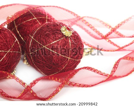 christmas burgundy balls and ribbon on white background