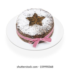 A stock photo of a Christmas cake on a white background