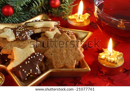 Christmas cakes and tea on red background