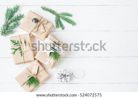 Christmas calendar. Christmas gift, fir branches, pine cones. Flat lay, top view.