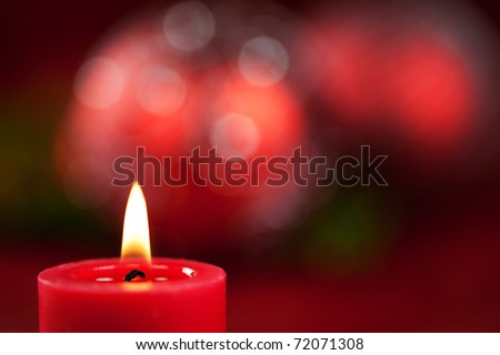 Christmas candle and festive background