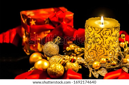 Christmas candle ang gifts view. Christmas candle light. Happy New Year and Merry Christmas