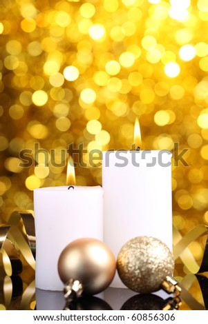 Christmas candle decoration on abstract light background - stock photo