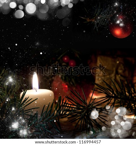 Christmas Candle in the background of spruce