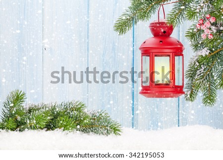 Christmas candle lantern on fir tree branch in snow. View with copy space - Shutterstock ID 342195053
