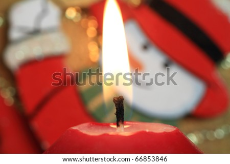 Christmas Candle  with smiling face - stock photo