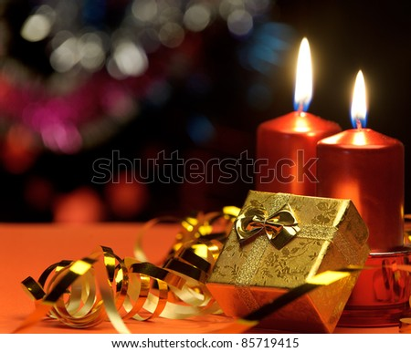 Christmas candles and gift boxes. A celebratory composition