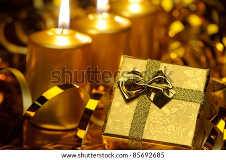 Christmas candles and gift boxes. Gold color