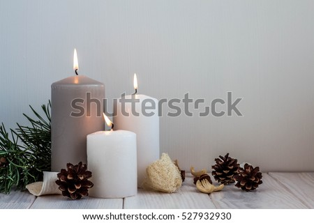 Christmas candles and lights on a old wooden table #527932930