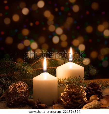 Christmas candles and ornaments over dark background with lights #221596594