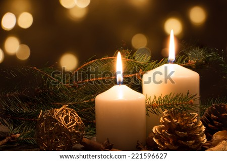 Christmas candles and ornaments over dark background with lights #221596627