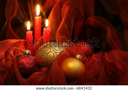 Christmas Candles & Baubles on a red background / horizontal