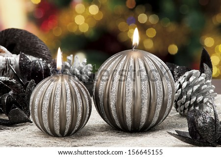 Christmas candles,baubles on background defocused lights