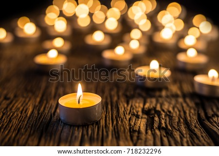 Christmas candles burning at night.