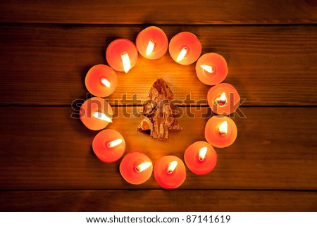 christmas candles circle over wood and bark tree symbol