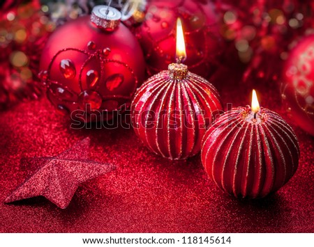 Christmas candles in red tone with glittering background