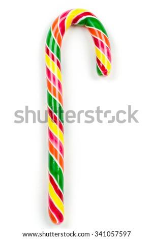 Christmas candy cane isolated on white. Studio shot #341057597