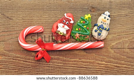 Christmas candy cane with christmas toy on wood background