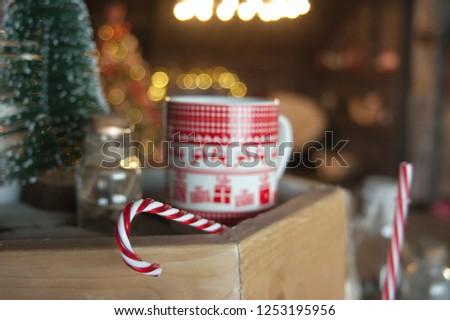 Christmas candy on the background of Christmas mug, Christmas mood #1253195956