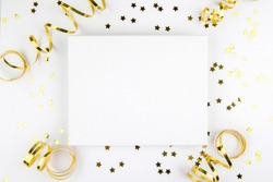 Christmas canvas mockup with golden festive decoration ribbon, stars on a white background. Design element for Christmas and New Year congratulation, thank you, greeting or invitation card, art work