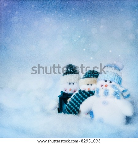 Christmas card. abstract  textured background with three snowman in the night and beautiful winter background