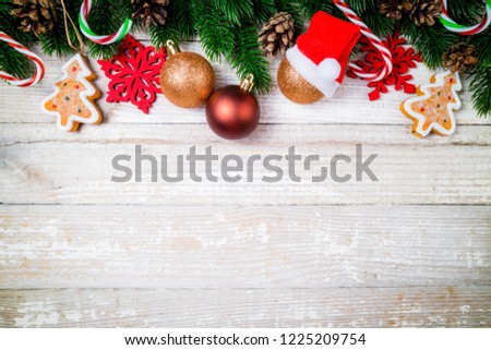 Christmas card. Christmas background with christmas fir tree, pine cones, candy canes, decorations and ornaments. Winter holidays concept. Top view #1225209754
