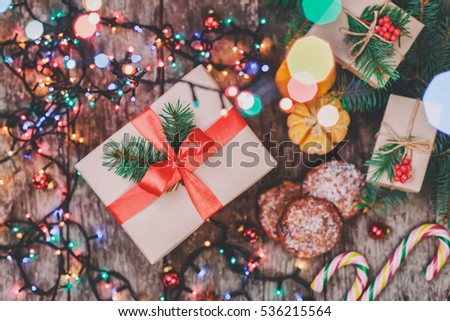 Christmas card. Christmas Cookies Chocolate, gifts, tangerines, candy on blur light  background. Xmas and Happy New Year composition. Top view. Selective focus. Toning #536215564