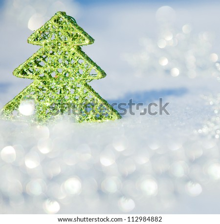 Christmas card. Christmas tree on snow. Winters background.
