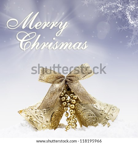Christmas card design of gold bell under the snow on blue defocused lights background