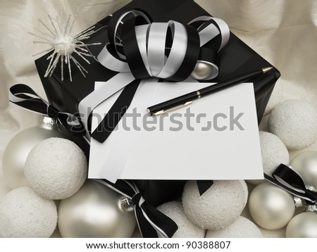 Christmas card on gift with pen and decoration