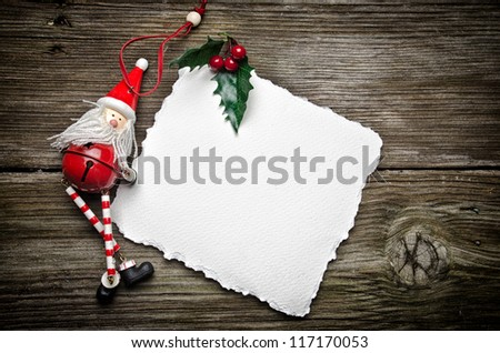 Christmas card on wooden top with christmas ornaments