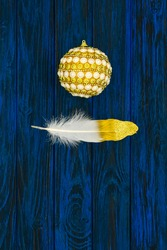 Christmas card. The concept consists of two items: a Christmas ball and a feather, made in a minimalist, abstract, symbolic style.