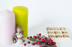 Christmas card with candles and Christmas set of toys with a branch of berries