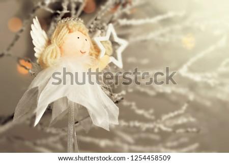 Christmas card with Christmas angel holding a star  #1254458509