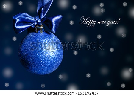 Christmas card with Christmas balls on a dark background