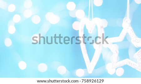 Christmas card with Christmas decorations on a sparkling blue background #758926129