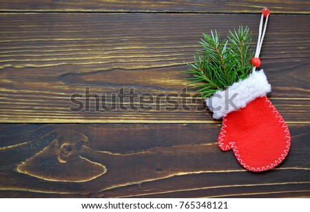 Christmas card with Christmas glove on wooden background #765348121